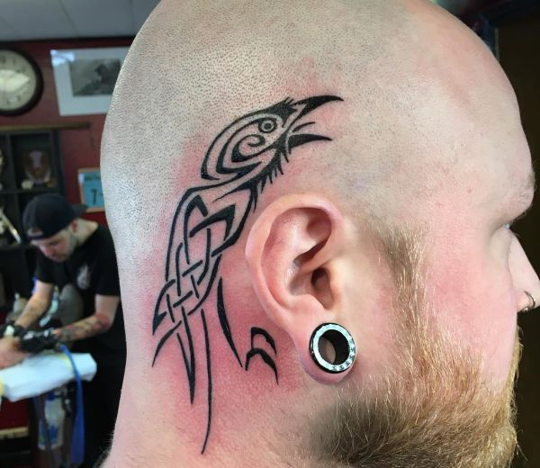 20 very lovely raven tattoos - additionally stands for battle and dying