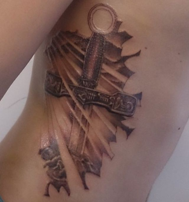 20 sword tattoo motifs and their symbolic which means