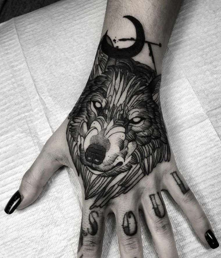 Wolf tattoo and wolf's head - fashions and which means in photos